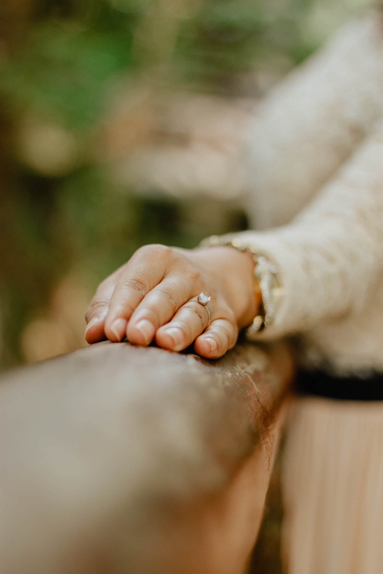 person-s-hand-with-engagement-ring-3809534
